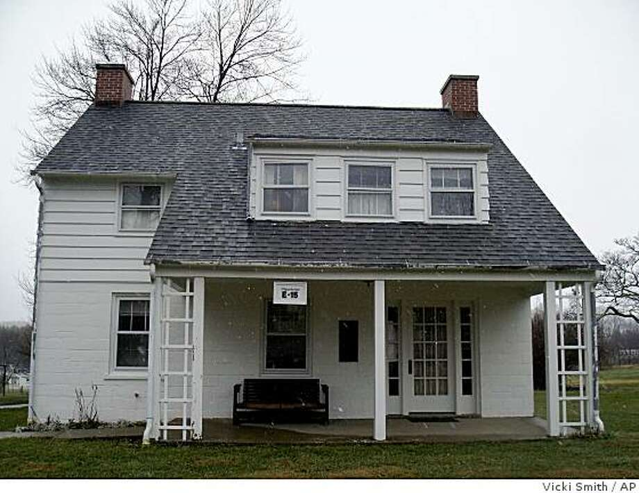 House E-15, whose original owner is identified as homesteader A. Wagner, has been preserved for tourism and remains furnished on Dec. 4, 2008, much as it was when the New Deal community of Arthurdale, W.Va., was built in the 1930's.  (AP Photo/Vicki Smith) Photo: Vicki Smith, AP