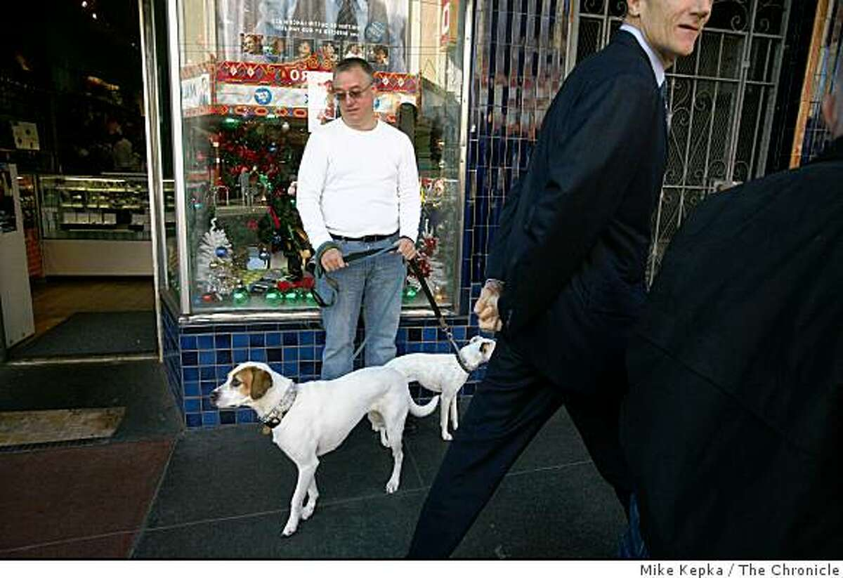 Retail Services manager for Macy's, Glenn Coffee with his dogs Dixie and Roxie, said he took the day off for the