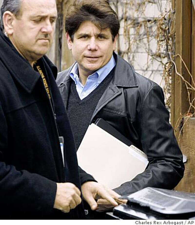 Illinois Gov. Rod Blagojevich, right, departs his home with a member of his security detail in Chicago, Saturday, Dec. 13, 2008. Prosecutors have accused Blagojevich of a litany of corruption allegations. (AP Photo/Charles Rex Arbogast) Photo: Charles Rex Arbogast, AP