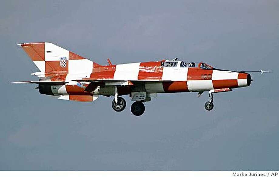 **APN ADVANCE FOR SUNDAY DEC. 14**  A June 11, 2006 photo shows as Soviet made MiG 21 fighter jet painted in the Croatian national colors during a show in in Varazdin, Croatia. (AP Photo/Marko Jurinec) Photo: Marko Jurinec, AP