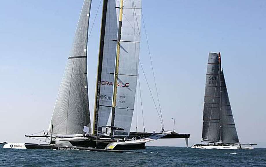 American BMW Oracle BOR 90, left, sails pass Swiss defender Alinghi 5, right, as they wait for the start of the 33rd America's Cup in Valencia, Spain, on Friday, Feb. 12, 2010. Photo: Victor R. Caivano, AP