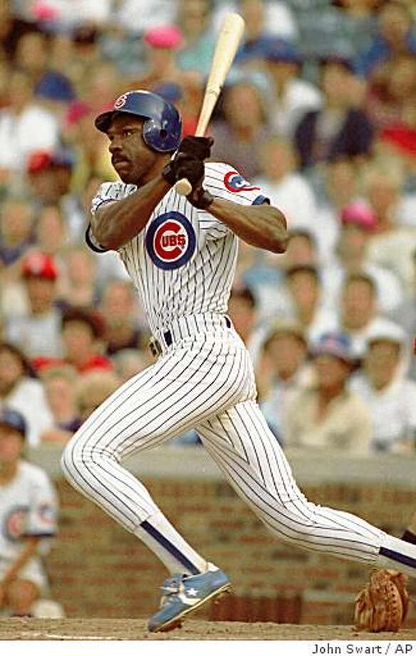 Chicago Cubs Andre Dawson singles in the game-winning run during a game against the Cardinals, August 8, 1990, in Chicago. Dawson, who has hit 437 home runs in a 21-year career, is expected to announce his retirement at age 42. (AP Photo/file/John Swart) Photo: John Swart, AP