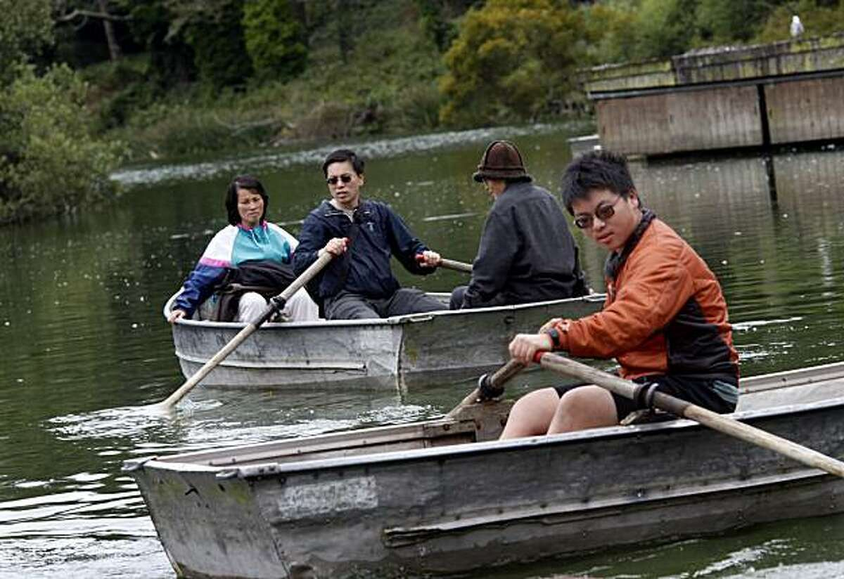 The Chan family of San Francisco rent some boats to explore Stow Lake Thursday July 22, 2010. The Recreation and Parks Department of San Francisco, Calif. has been looking for a new vendor to take over concessions at the Stow Lake boat house.