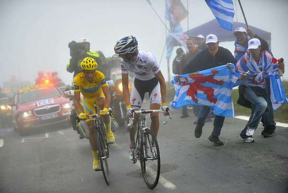 Stage winner Andy Schleck of Luxembourg, wearing the best young rider's white jersey, right, and Alberto Contador of Spain, left,  climb Tourmalet pass in dense fog during the 17th stage of the Tour de France cycling race over 174 kilometers (108.1 miles)with start in Pau and finish on Tourmalet pass, Pyrenees region, France, Thursday, July 22, 2010. Photo: Lionel Bonaventure, AP