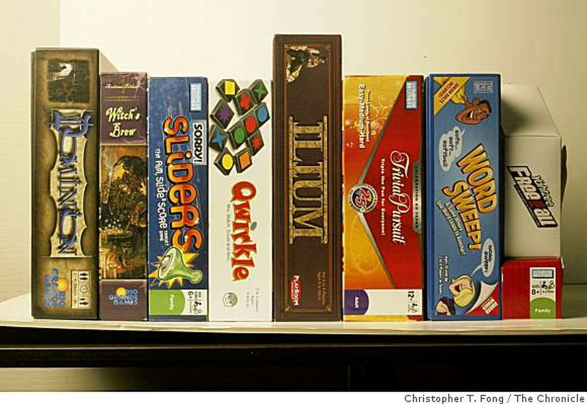 for boardgames11 in sunday datebook:the games in this photo: Dominion, Witch's Brew, Sorry! Sliders, Qwirkle, Ilium, Trivia Pursuit: The 25th Anniversary, Word Sweep!, Yahtzee Free for All