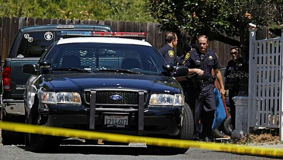 Concord Police along with Contra Costa Animal authorities investigate the death of a 2-year-old Concord boy that was mauled to death by family's three pit bulls Thursday July 22, 2010 in the familyÕs home garage. Photo: Lance Iversen, The Chronicle