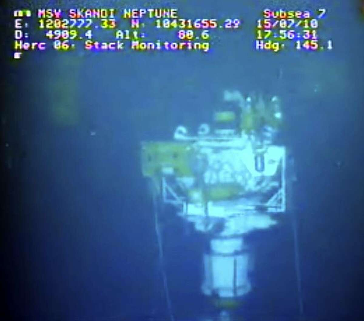 This image taken from video provided by BP PLC at 17:56 CDT shows that oil has stopped flowing from the new 75-ton cap atop the site of the Deepwater Horizon oil spill in the Gulf of Mexico Thursday, July 15, 2010. BP finally choked off the flow of oil into the Gulf of Mexico on Thursday _ 85 days and up to 184 million gallons after the crisis unfolded _ then began a tense 48 hours of watching to see whether the capped-off well would hold or blow a new leak. Engineers will monitor pressure gauges and watch for signs of leaks elsewhere in the well. (AP Photo/BP PLC) NO SALES