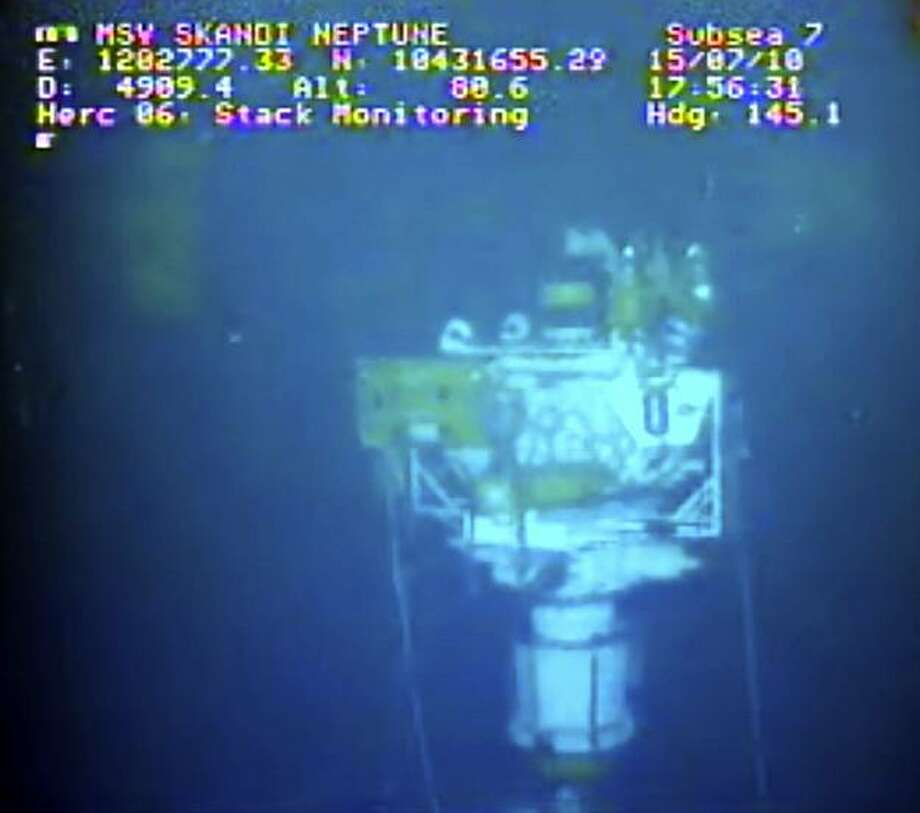 This image taken from video provided by BP PLC at 17:56 CDT shows that oil has stopped flowing from the new 75-ton cap atop the site of the Deepwater Horizon oil spill in the Gulf of Mexico Thursday, July 15, 2010. BP finally choked off the flow of oil into the Gulf of Mexico on Thursday _ 85 days and up to 184 million gallons after the crisis unfolded _ then began a tense 48 hours of watching to see whether the capped-off well would hold or blow a new leak. Engineers will monitor pressure gauges and watch for signs of leaks elsewhere in the well. (AP Photo/BP PLC) NO SALES Photo: AP