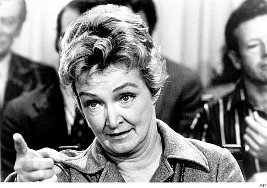 """** FILE ** In this file photo released by ABC, actress Nina Foch appears in a scene from """"A Lesson in Loving"""". Foch, who often played cool, calculating women in films, theater and television and later became a respected acting coach died at the Ronald Reagan UCLA Medical Center on Friday Dec. 5, 2008 from complications from a blood disorder. She was  84. Foch made her film debut in 1943 and appeared in such movies as """"An American in Paris,"""" """"The Ten Commandments,"""" """"Spartacus,"""" """"Rich and Famous"""" and """"Sliver.""""(AP Photo/ABC, File)  ** NO SALES ** Photo: AP"""