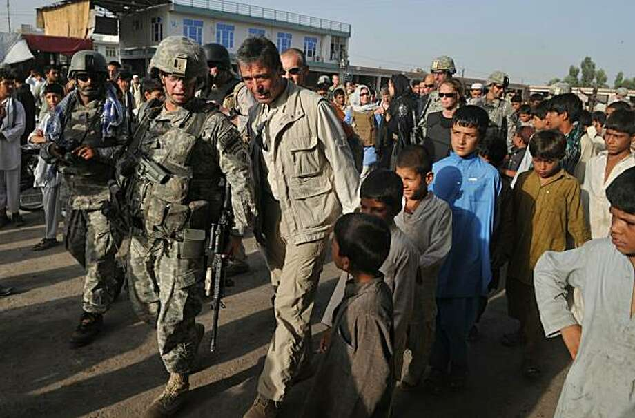 "NATO Secretary General Anders Fogh Rasmussen (C) walks in a public market in Jalalabad city in Nangarhar province on July 19, 2010. The international community failed to fully appreciate the difficulty of defeating the Taliban and rebuilding Afghanistan,NATO Secretary General Anders Fogh Rasmussen said Monday. ""I believe the international community underestimated the mission in Afghanistan,"" Rasmussen said in an interview with Danish TV station TV2 News ahead of a conference of donors in Kabul Tuesday. Photo: Massoud Hossaini, AFP/Getty Images"