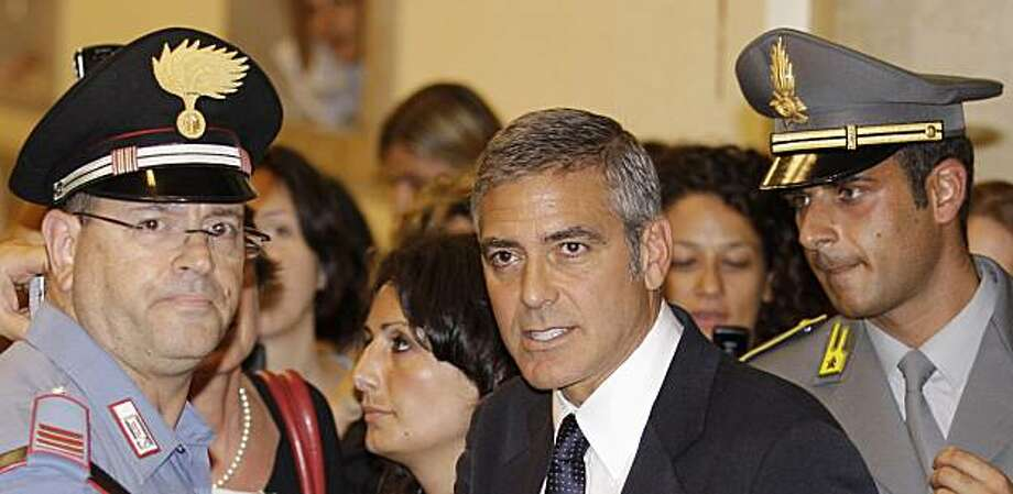 U.S. actor George Clooney  leaves the tribunal in Milan, Italy, Friday, July 16, 2010. Clooney appeared in court as a witness in a fraud trial against defendants charged with co opting his name for a line of clothing. Photo: Luca Bruno, AP