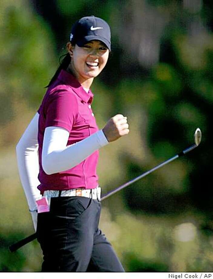 In this Dec. 7, 2008 photo, Michelle Wie pumps her fist after sinking a chip shot on the 17th green for a birdie during the final round of the LPGA qualifying tournament at LPGA International in Daytona Beach, Fla. Wie earned her LPGA playing card by finishing on the top 20 of the Q-school tournament.  (AP Photo/Daytona Beach News-Journal, Nigel Cook) Photo: Nigel Cook, AP