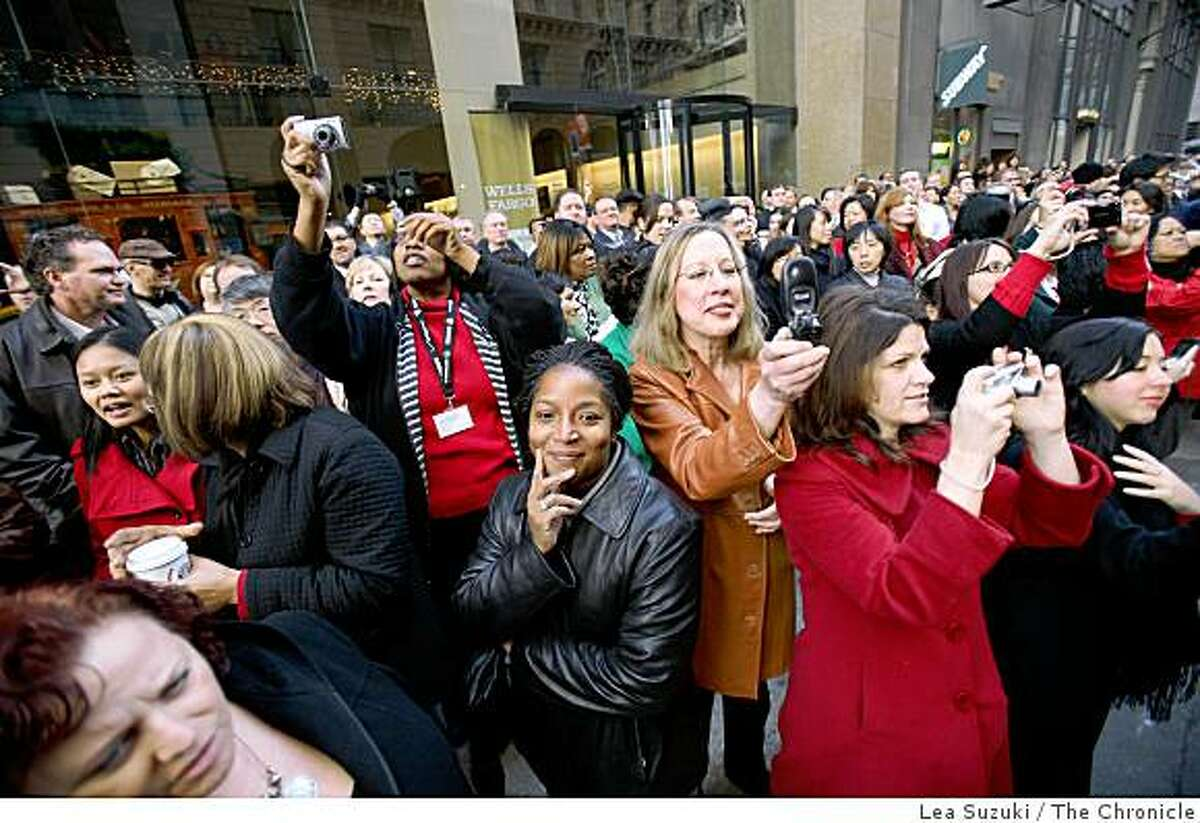 People gather and watch as the Wells Fargo horse-drawn stagecoach arrives at the Wells Fargo History Museum on Montgomery Street on Wednesday, December 10, 2008.