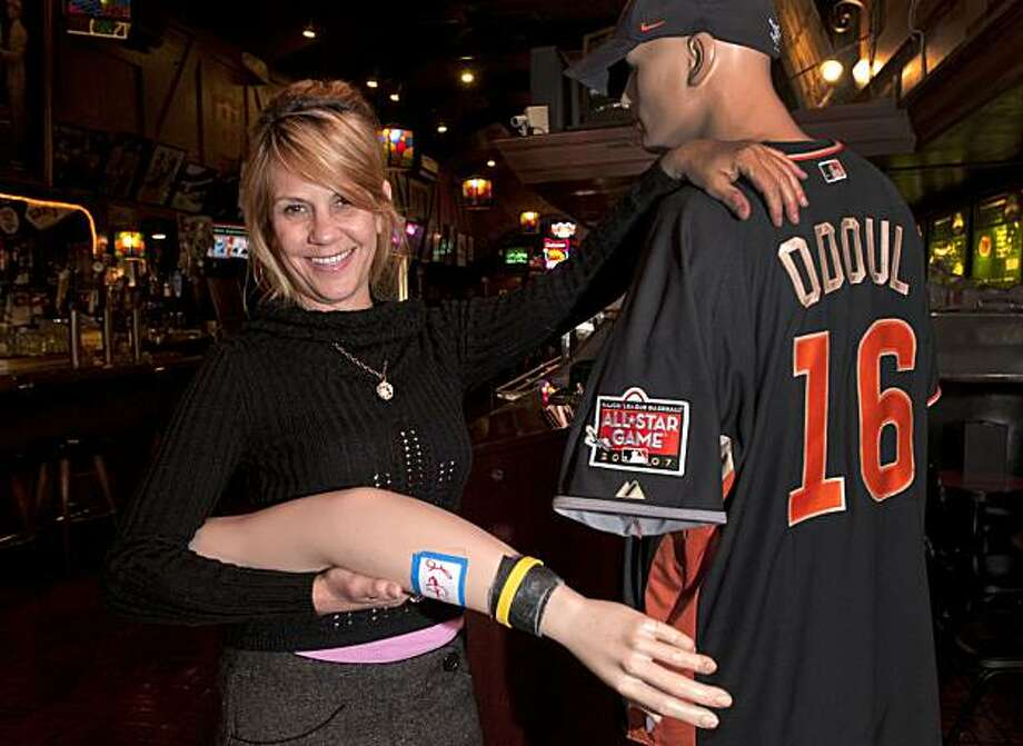 "Darlene Sularski poses with the left arm of the mannequin from ""Lefty O'Doul's Restaurant and Lounge"" on July 20, 2010 in San Francisco, Calif., which was returned via USPS after being stolen 3 years ago. Photo: Chad Ziemendorf, The Chronicle"