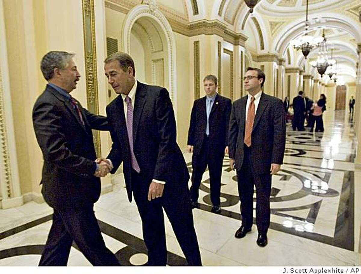 The House Republican leader, Rep. John A. Boehner, R-Ohio, second from left, gets a word of consolation from Rep. John Salazar, D-Colo., left, after the auto industry bailout vote passed in the face of strong GOP opposition, at the Capitol in Washington, Wednesday, Dec. 10, 2008. Boehner said the legislation