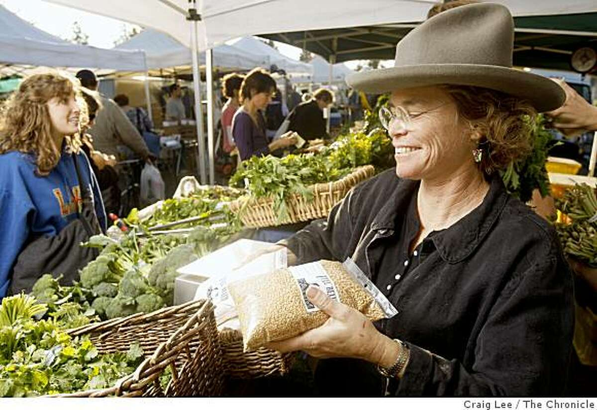 Judith Redmond, a farmer at Full Belly Farm, selling her wheat berries and wheat flour at the farmers market in Berkeley, Calif., on December 2, 2008.