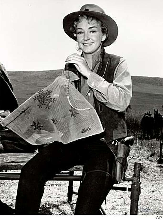"In this May 1959 file photo, actress Nina Foch works on a needlepoint seat cover between scenes while guest starring in the ""Rawhide"" episode of "" Incident of the Judas Trap"". Foch, who often played cool, calculating women in films, theater and television and later became a respected acting coach died at the Ronald Reagan UCLA Medical Center on Friday Dec. 5, 2008 from complications from a blood disorder. She was  84. Foch made her film debut in 1943 and appeared in such movies as ""An American in Paris,"" ""The Ten Commandments,"" ""Spartacus,"" ""Rich and Famous"" and ""Sliver."" Photo: AP"