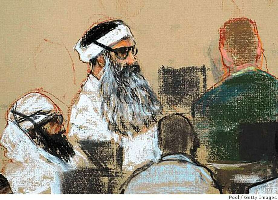 GUANTANAMO BAY, CUBA - DECEMBER 8:  An image of a courtroom drawing by artist Janet Hamlin, reviewed by the U.S. military, shows Khalid Sheikh Mohammed (C) and co-defendant Walid Bin Attash (L) attending a pre-trial session December 8, 2008 in Guantanamo Bay, Cuba. Khalid Sheikh Mohammed, the alleged mastermind of the September 11, 2001 attacks, is appearing today before a U.S. military tribunal where he will face victims' kin for the first time.  (Sketch by Janet Hamlin-Pool/Getty Images) Photo: Pool, Getty Images
