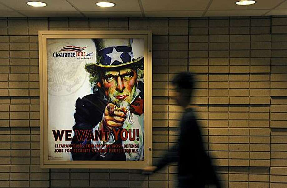 As the federal government continues to expand its top-secret activities, workers with security clearances are in high demand. This poster hangs in Crystal City, Va., home to many defense contractors. Illustrates TOPSECRET (category a), by Dana Priest and William M. Arkin (c) 2010, The Washington Post. Moved Sunday, July 18, 2010. (MUST CREDIT: Washington Post photo by Michael S. Williamson) Photo: Williamson, The Washington Post