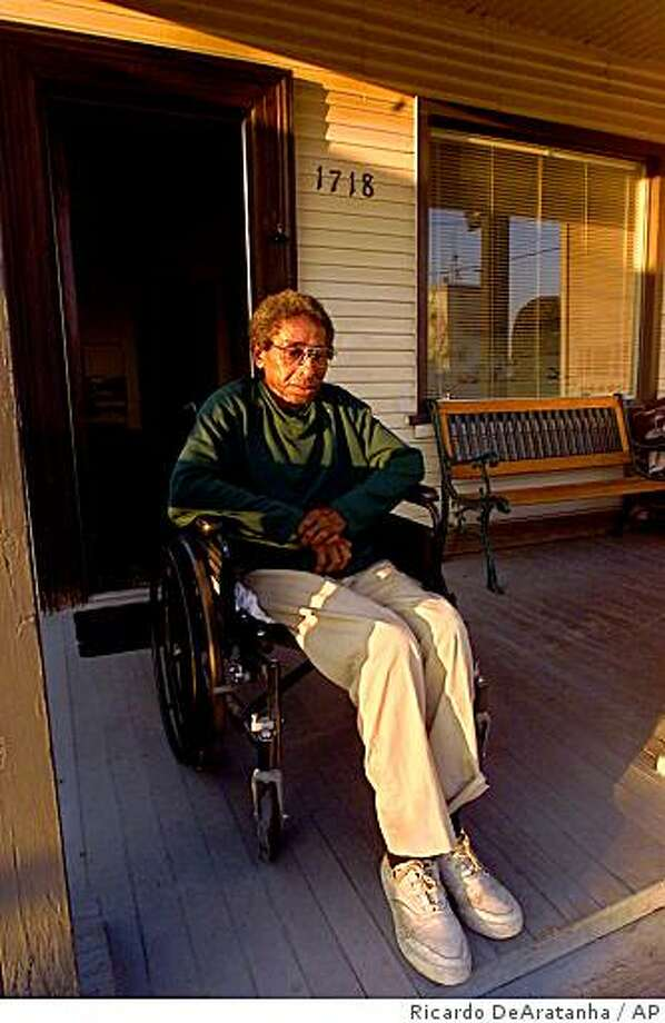 Joe Dabney sits on his porch in Bakersfield, Calif., Feb. 20, 2002. His wife Margie Dabney, 70, who has Alzheimer's disease, vanished after their plane landed Dec. 5, 2002, at Dallas-Fort Worth International Airport. She managed to wander off and has not been seen since. (AP Photo/Los Angeles Times, Ricardo DeAratanha) Photo: Ricardo DeAratanha, AP