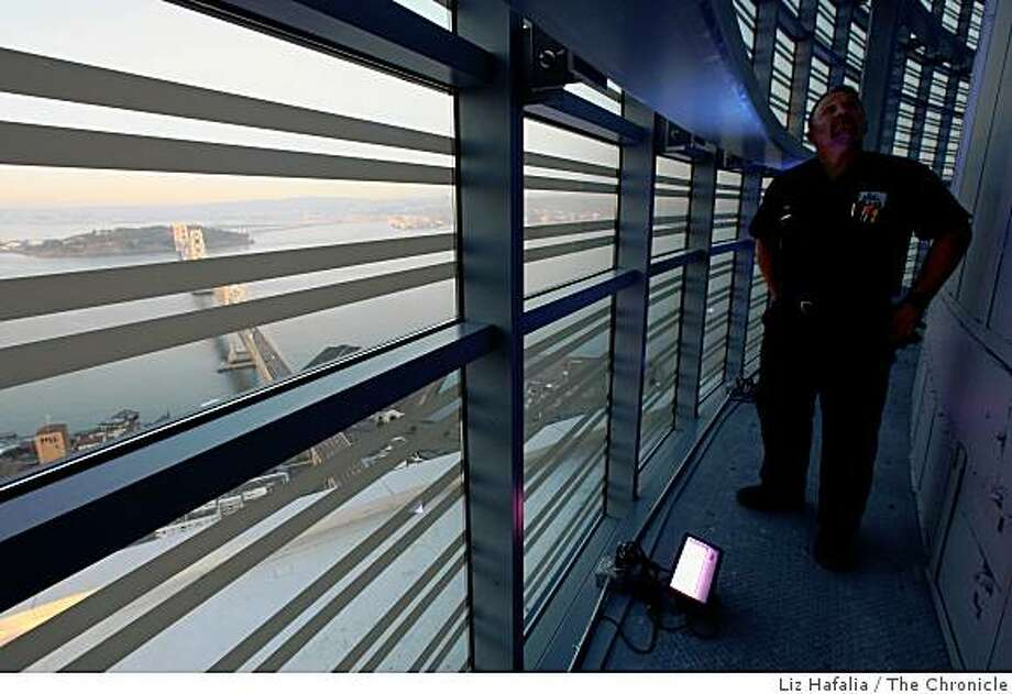 Chief engineer Ben Irving shows off the new LED lights at the Rincon Hill tower in San Francisco, Calif,  on Monday, December 8, 2008. Starting tomorrow, the lights will change colors depending on the city's weather. Photo: Liz Hafalia, The Chronicle