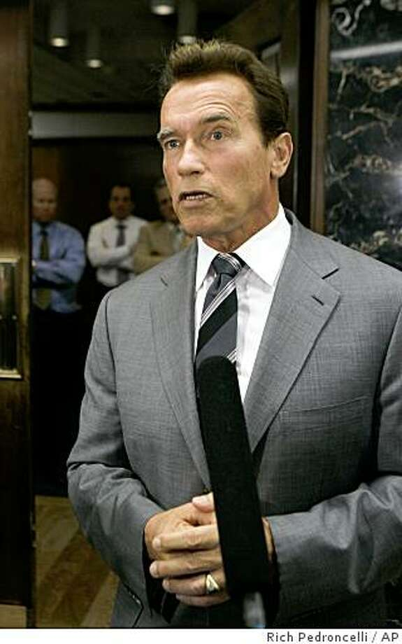Gov. Arnold Schwarzenegger talks with reporters about the Legislature's  failure to reach a solution to the state budget deficit, outside his Capitol office in Sacramento, Calif., Tuesday, Nov. 25, 2008.  The Legislature failed to approve a Democratic budget package which included $8.1 billion in budget cuts and $8.1 billion in new revenues.(AP Photo/Rich Pedroncelli) Photo: Rich Pedroncelli, AP
