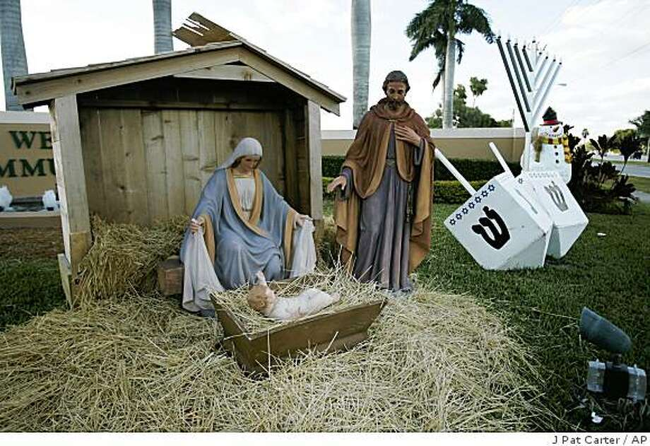 Wellington, Fla.'s holiday display is outside the community center, Monday, Dec. 8, 2008. When Baby Jesus disappeared from the creche in front of the community center_village officials did not follow a star to locate Jesus. A GPS device had been mounted inside the ceramic figure that led them to a nearby apartment and the arrest of a 18-year-old girl. More than 70 churches have taken advantage of a security company offer of tracking devices. (AP Photo/J Pat Carter) Photo: J Pat Carter, AP