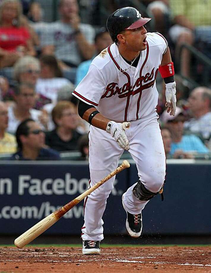 Atlanta Braves' Martin Prado hits a solo home run in the third inning against the Milwaukee Brewers at Turner Field in Atlanta, Georgia, on Thursday, July 15, 2010. (Curtis Compton/Atlanta Journal-Constitution/MCT) Photo: Curtis Compton, MCT