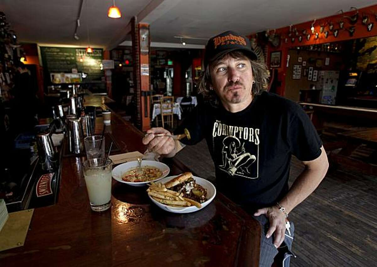 """San Francisco's quintessential rock """"n"""" roll bartender, Johnny Davis, who owns Bender's Bar and Grill, shares one of his favorite places to visit in the city, Buckshot Restaurant Bar and Gameroom on Geary Street in San Francisco, Ca. on Friday June 11, 2010. Davis enjoys a recent luch at the Buckshot, sloppy Joe, sweet corn chowder and absinthe with simple syrup and ice to drink."""
