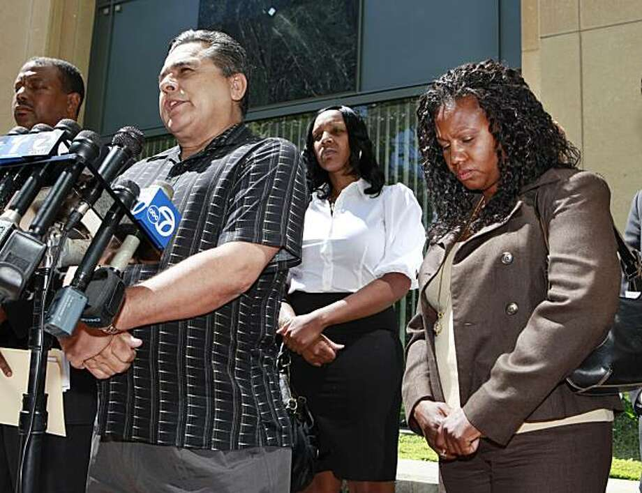 Former New United Motor Manufacturing Inc. (NUMMI) employees, from left to right, David Botello, Niysha Edward, and June Andrade, appear during a news conference, Wednesday, July 14, 2010, at the entrance of the Federal Building in Oakland, Calif. A groupof former employees are suing the factory and Toyota Motor Corp., claiming they were not given fair severance packages because they were on disability leave. Photo: Paul Sakuma, AP