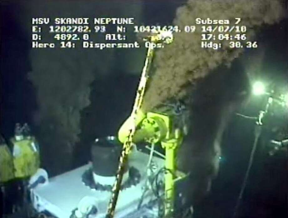 In this image taken from video provided by BP PLC at 17:04 CDT, oil has stopped flowing from the center valve as testing of the new 75-ton cap atop the site of the Deepwater Horizon oil spill in the Gulf of Mexico begins Wednesday, July 14, 2010. The federal government gave BP the green light Wednesday to try choking off the Gulf of Mexico oil gusher with the untested metal cap after a daylong delay to satisfy worries about whether the project might make the leak worse. (AP Photo/BP PLC) NO SALES Photo: Anonymous, AP