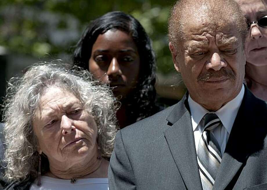 Susan Harman (left) and Walter Riley, both arrested during the protests following the Mehserle verdict, listen during a press conference held in front of Oakland City Hall on Wednesday, July 14, 2010 to discuss the actions of police as they arrested protestors following the verdict in the Mehserle case. Photo: Chad Ziemendorf, The Chronicle