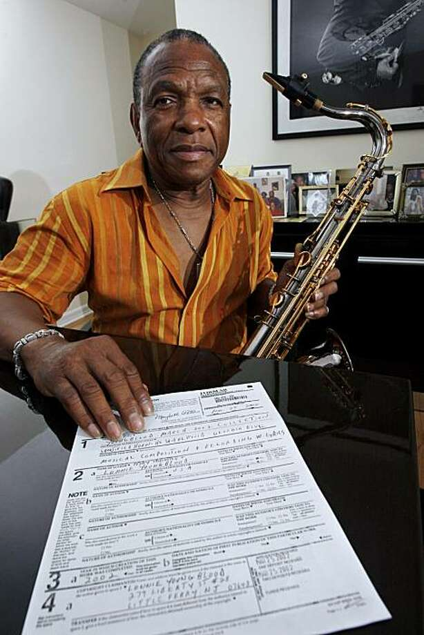 """In this Monday, July 12, 2010 photo, Lonnie Youngblood sits with his saxophone and a copyright notice for one of his songs at his home in Lodi, N.J. In the mid-1960s, after briefly playing in Youngblood's band,  Jimmy James, eventually went back to usinghis real last name and conquered the music world as Jimi Hendrix, while Youngblood fronted a series of rhythm and blues bands that toured with James Brown, Sam and Dave, Jackie Wilson and other '60s legends. In 1969, at the peak of Hendrix' popularity, the two men recorded several songs in a New York studio. The tunes recorded during those two or three days are the subject of a lawsuit Youngblood filed this spring that claims one of the songs, """"Georgia Blues,"""" was included on a 2003 compilation without Photo: Mel Evans, Associated Press"""