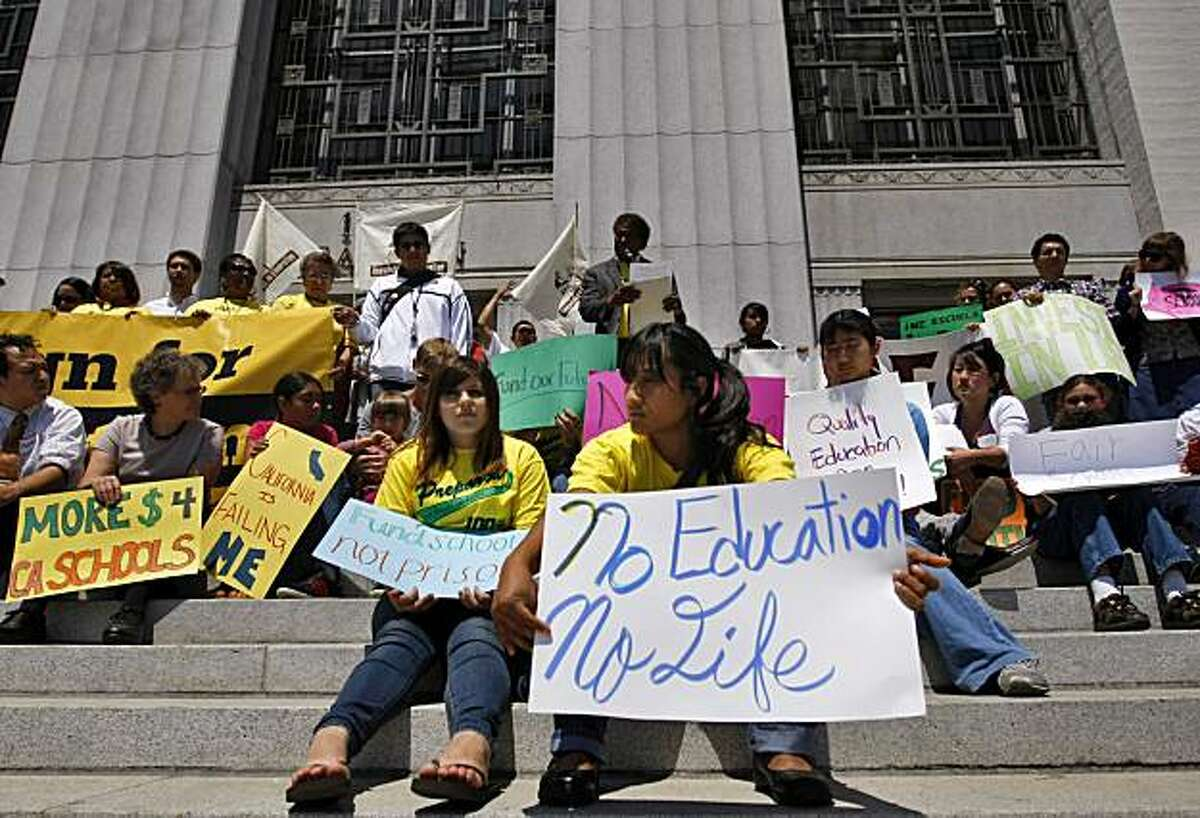 A coalition of thirty people representing thousands of low-income students and parents gather outside the Rene C. Davidson Alameda County Courthouse, Monday July 12, 2010, in Oakland, Calif. The group were there to announce the suit against the state overA coalition of thirty people representing thousands of low-income students and parents gather outside the Rene C. Davidson Alameda County Courthouse, Monday July 12, 2010, in Oakland, Calif. The group were there to announce the suit against the state over a school funding system that they say doesn't serve the neediest kids.