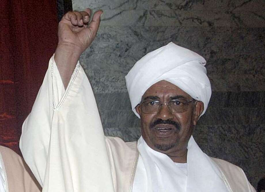 FILE - In this May 27, 2010 file photo, Sudan's president Omar al-Bashir gestures prior to being sworn in, at the parliament in Khartoum, Sudan. On Monday, July, 12, 2010, the International Criminal Court in The Hague, Netherlands, charged Sudanese President Omar al-Bashir with three counts of genocide in Darfur, a move that will pile further diplomatic pressure on his isolated regime. The decision marked the first time the world's first permanent war crimes tribunal has issued genocide charges. Photo: Abd Raouf, AP