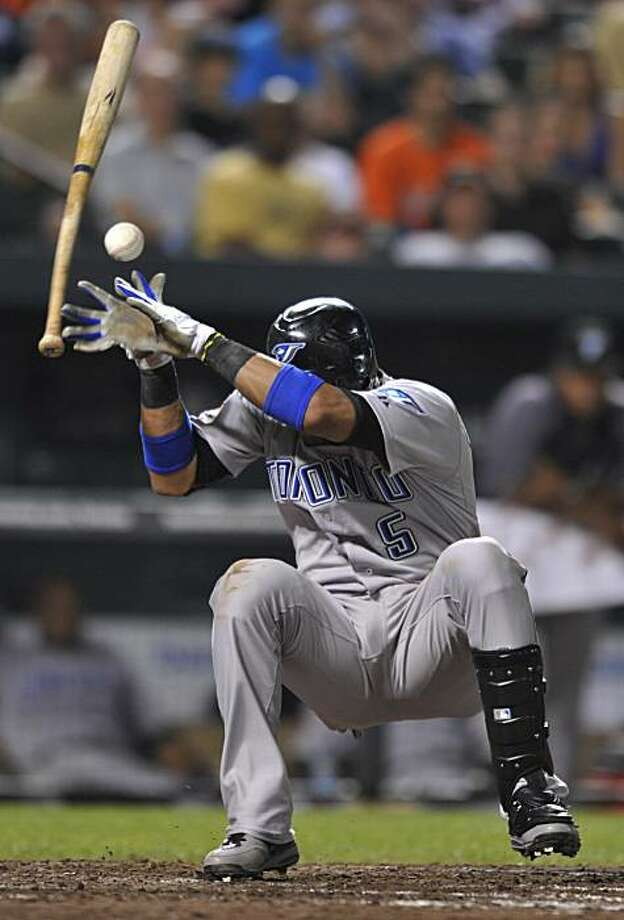 Toronto Blue Jays Yunel Escobar reacts after his bat is hit by a pitch by Baltimore Orioles Jason Berken in the ninth inning of a baseball gameSaturday, July 17, 2010 in Baltimore. The Blue Jays won 3-2. Photo: Gail Burton, AP