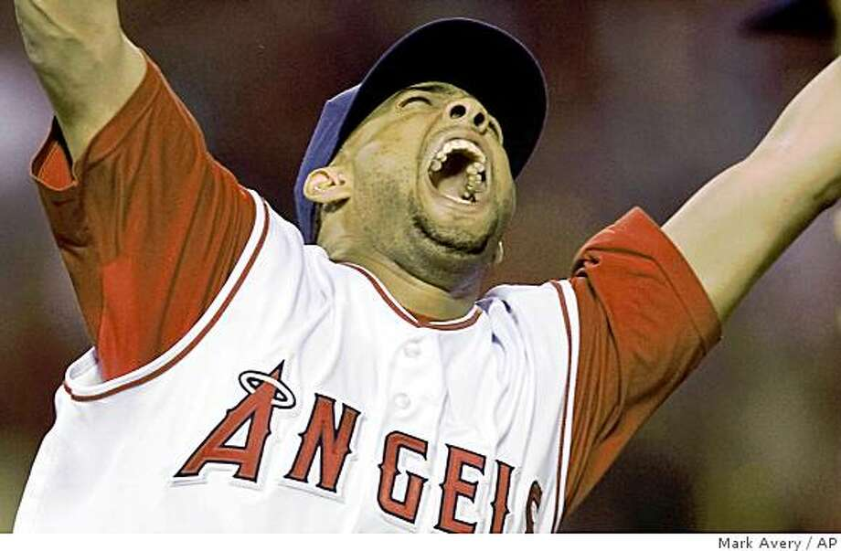 ** FILE ** In this Sept. 11, 2008 file photo, Los Angeles Angels relief pitcher Francisco Rodriguez celebrates after the final out of his 57th save this season in an MLB baseball game against the Seattle Mariners in Anaheim, Calif. The record-setting Rodriguez and the New York Mets reached a preliminary agreement on Tuesday, Dec. 9, 2008 on a $37 million, three-year contract. (AP Photo/Mark Avery, File) Photo: Mark Avery, AP