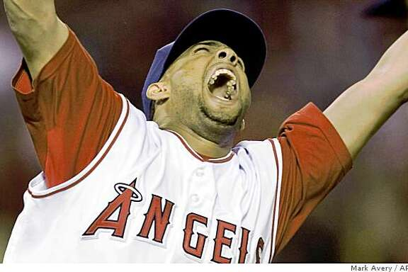 ** FILE ** In this Sept. 11, 2008 file photo, Los Angeles Angels relief pitcher Francisco Rodriguez celebrates after the final out of his 57th save this season in an MLB baseball game against the Seattle Mariners in Anaheim, Calif. The record-setting Rodriguez and the New York Mets reached a preliminary agreement on Tuesday, Dec. 9, 2008 on a $37 million, three-year contract. (AP Photo/Mark Avery, File)