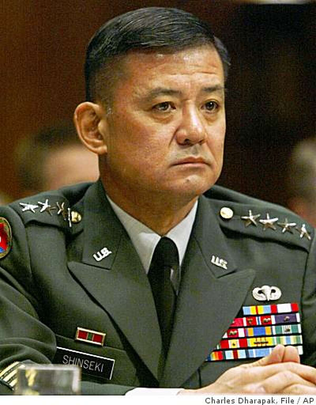 ** FILE ** This Feb. 25, 2003 file photo shows Gen. Eric K. Shinseki, then Chief of Staff of the United States Army, attends the Senate Armed Services committee hearing regarding the Defense Authorization Request for 2004 on Capitol Hill in Washington. U.S. President-elect Barack Obama has selected retired Gen. Eric K. Shinseki to be VA secretary according to Democratic officials, Saturday Dec. 6, 2008. (AP Photo/Charles Dharapak, File)