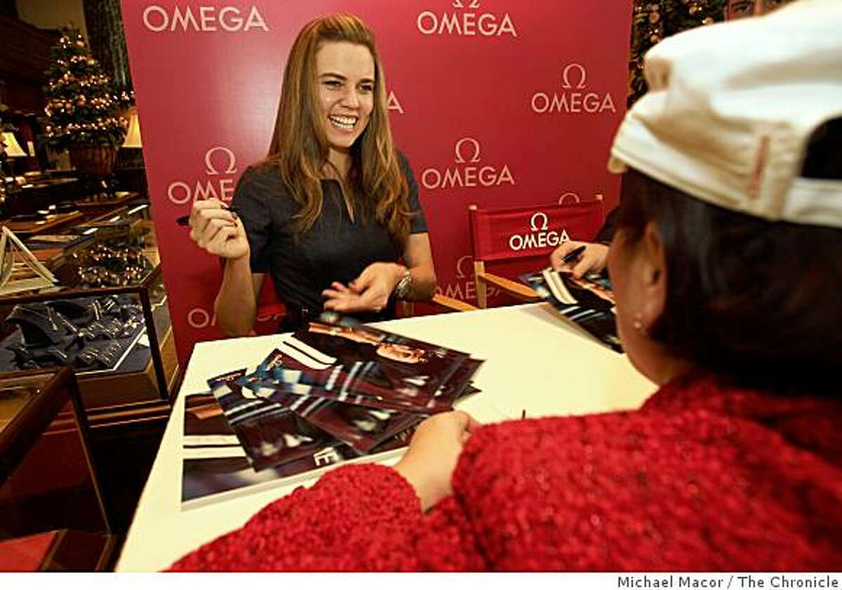Olympic champion swimmer, Natalie Coughlin, signs pictures for fans, during a promotion at Shreve & Co. in San Francisco, Calif., on Thursday Nov. 20, 2008. Coughlin is an ambassador for the company.