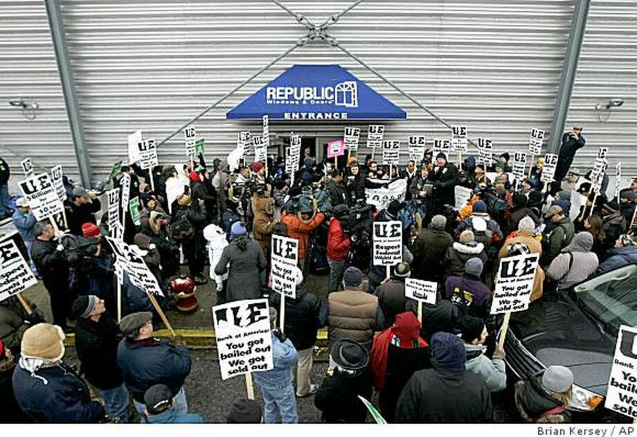 Workers and union organizers rally outside of the Republic Windows and Doors factory on Saturday, Dec. 6, 2008 in Chicago. Workers laid off from their jobs at the factory have occupied the building since Friday and are demanding assurances they'll get severance and vacation pay that they say they are owed. (AP Photo/Brian Kersey) Photo: Brian Kersey, AP