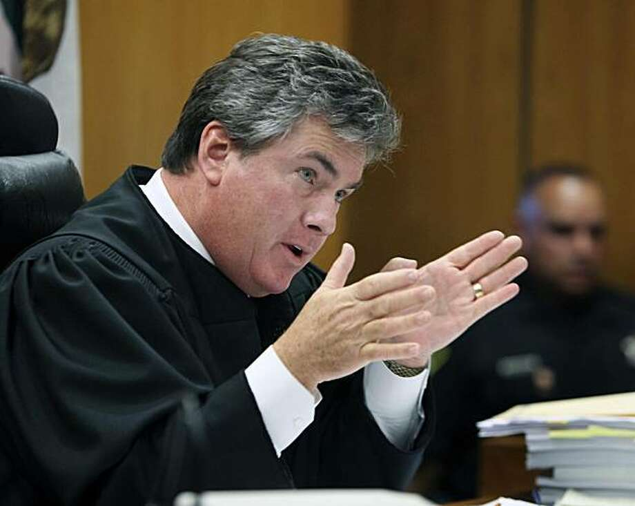 Sacramento Superior Court Judge Patrick Marlette gestures as he discusses his decision to deny a request for a temporary restraining order to pay state employees minimum wage,  during a hearing in in Sacramento, Calif., Friday, July 16, 2010. Saying it would cause too much harm to employees,  Marlette denied Gov. Arnold Schwarzenegger's request for a temporary restraining order that would have forced Controller John Chiang to pay the federal minimum wage immediately to about 200,000 state workers.  The decision means state workers will continue to receive their full wages in July and August. Photo: Rich Pedroncelli, AP