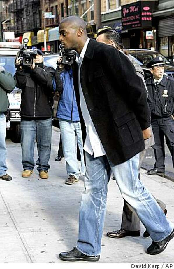 ** ADVANCE FOR WEEKEND EDITIONS, DEC. 6-7 -- FILE -- ** In this Dec. 1, 2008 file photo,  New York Giants' Plaxico Burress arrives at Manhattan Supreme Court for arraignment,  in New York. Many NFL players recoil when they think about what Plaxico Burress is going through _ and what still awaits. (AP Photo/David Karp, File) Photo: David Karp, AP