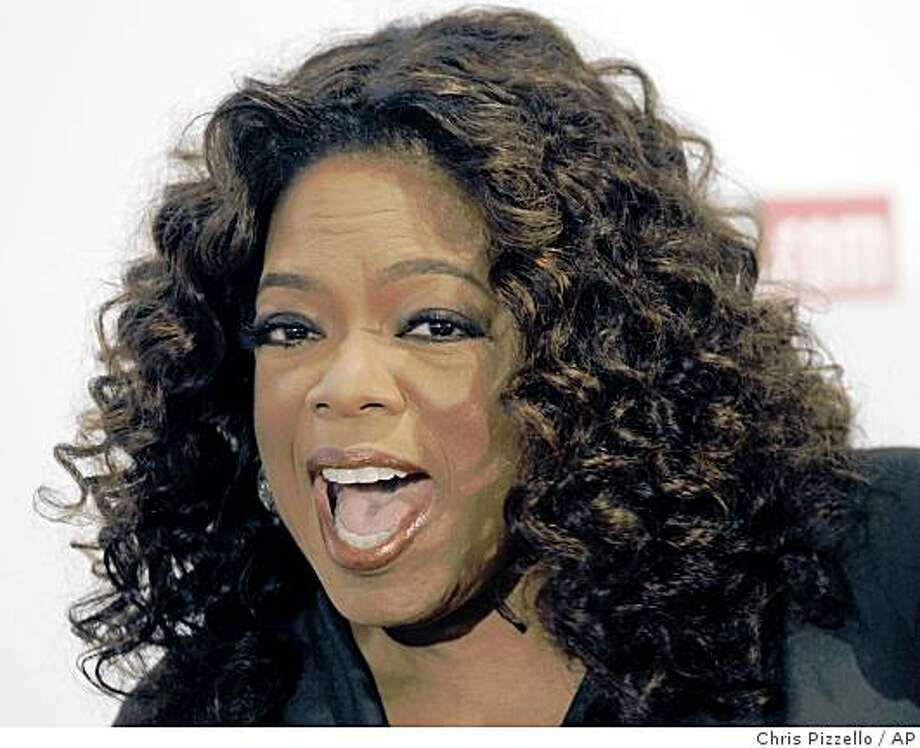 Oprah Winfrey poses for photographers at The Hollywood Reporter's annual Women in Entertainment Breakfast in Beverly Hills, Calif., Friday, Dec. 5, 2008. (AP Photo/Chris Pizzello) Photo: Chris Pizzello, AP