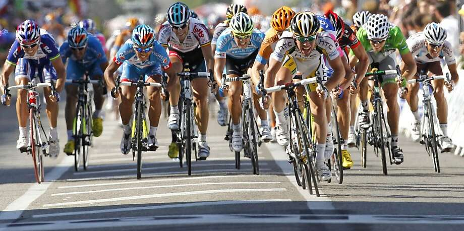 Yukiya Arashiro of Japan, third from left, Tyler Farrar of the US, center with orange helmet, stage winner Mark Cavendish of Britain, leading, and Thor Hushovd of Norway, right in the best sprinter's green jersey,  sprint towards the finish line to win the 11th stage of the Tour de France cycling race over 184.5 kilometers (114.6 miles) with start in Sisteron and finish in Bourg-les-Valences, France, Thursday, July 15, 2010. Photo: Bas Czerwinski, AP