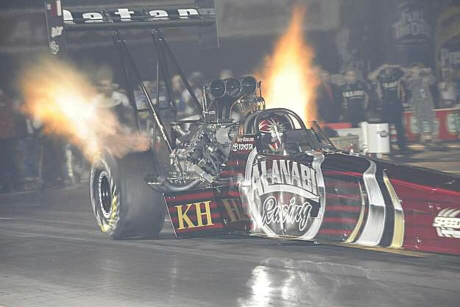Larry Dixon's top-fuel dragster breathes fire during a qualifying run at the Winternationals in Pomona (Los Angeles County) in February 2010. Photo: Ron Lewis/Al-Anabi Racing