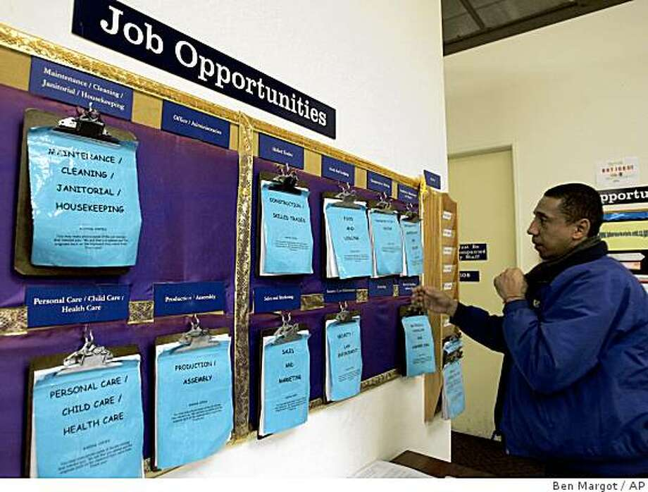 David Araujo of Berkeley, Calif., searches the job listings at the One-Stop Career Center Friday, Dec. 5, 2008, in Oakland, Calif. Skittish employers slashed 533,000 jobs in November, the most in 34 years, catapulting the unemployment rate to 6.7 percent, dramatic proof the country is careening deeper into recession. (AP Photo/Ben Margot) Photo: Ben Margot, AP