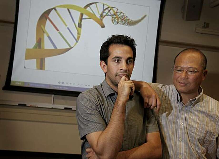 Against the background of a human double helix DNA illustration stand Keyan Salari, medical student and PhD candidate (left) and Professor Stuart Kim.  Both men run the new course. Stanford University's School of Medicine is the first in the nation to offer a course training future doctors to map and interpret their own genetic data. Photo: Brant Ward, The Chronicle