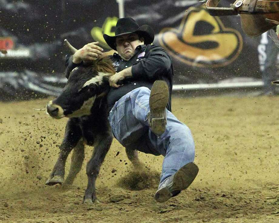 Luke Branquinho competes in the steer wrestling competition at the San Antonio Rodeo on Friday, Feb. 10, 2012. Kin Man Hui/San Antonio Express-News Photo: Kin Man Hui, ~ / San Antonio Express-News