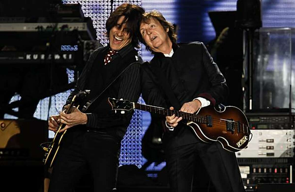 Bandmate Rusty Anderson, (left) joins Sir Paul McCartney on stage as the band plays a sold out show at AT&T Park in San Francisco, Ca. on Saturday July 10, 2010.